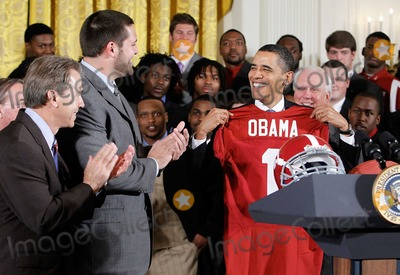 Alex Wong Photo - United States President Barack Obama (R) receives a jersey as head coach Nick Saban (L) and offenisve line Mike Johnson (2nd L) look on during an East Room event to host members of the Alabama Crimson Tide Monday March 8 2010 at the White House in Washington DC Obama welcomed the 2009 BCS Champions to honor its 13th championship and an undefeated season  Photo by Alex WongPool-CNP-PHOTOlinknet
