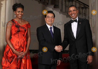 Alex Wong Photo - WASHINGTON DC - JANUARY 19  US President Barack Obama (R) shakes hands with Chinese President Hu Jintao (C) as first lady Michelle Obama looks on as they pose for the official photo at the Grand Staircase of the White House January 19 2011 in Washington DC Obama is hosting a state dinner for Hu this evening  (Photo by Alex WongGetty Images)