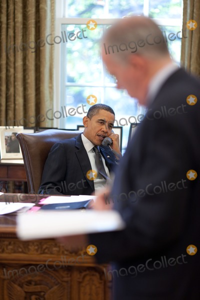 John Brennan Photo - OBAMA ON PHONEUnited States President Barack Obama talks on the phone in the Oval Office November 2 2010 John Brennan Assistant to the President for Homeland Security and Counterterrorism stands at right Photo by Pete SouzaWhite House via CNP-PHOTOlinknet