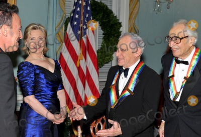 Dave Brubeck Photo - Washington DC - December 5 2009 -- United States Secretary of State Hillary Rodham Clinton left center enjoys a smile as the 2009 Kennedy Center honorees assemble for the formal group photo following the Artists Dinner at the United States Department of State in Washington DC on Saturday December 5 2009  From left to right Bruce Springsteen Secretary Clinton Mel Brooks and Dave BrubeckPhoto by Ron SachsPool-CNP-PHOTOlinknet