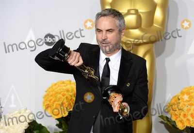 Alfonso Cuaron Photo - Photo by Doug PetersstarmaxinccomSTAR MAX2014ALL RIGHTS RESERVEDTelephoneFax (212) 995-11963214Alfonso Cuaron at the 86th Annual Academy Awards (Oscars)(Hollywood CA)