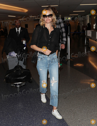 Amber Valletta Photo - Photo by SMXRFstarmaxinccomSTAR MAX2017ALL RIGHTS RESERVEDTelephoneFax (212) 995-1196101717Amber Valletta is seen at LAX Airport in Los Angeles CA
