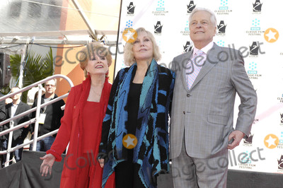 Graumans Chinese Theatre Photo - Photo by Michael Germanastarmaxinccom2012ALL RIGHTS RESERVED41412Kim Novak Debbie Reynolds and Robert Osborne during a ceremony honoring Kim Novak with her Handprints and Footprints immortalized in cement at Graumans Chinese Theatre in Los Angeles CA