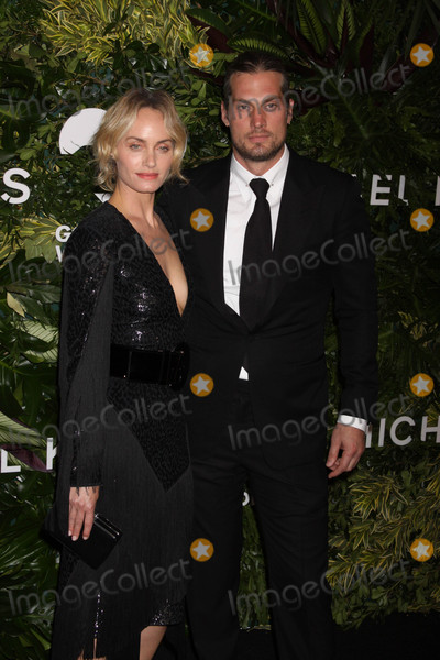 Amber Valletta Photo - Photo by Victor MalafrontestarmaxinccomSTAR MAX2017ALL RIGHTS RESERVEDTelephoneFax (212) 995-1196101617Amber Valletta and Teddy Charels at The 11th Annual Gods Love We Deliver Golden Heart Awards in New York City