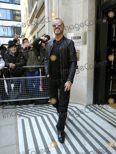 New Order Photo - In a pair of trendy shades George Michael who has been rumored to be a possible judge for Simon Cowells US version of the hit music reality show X Factor arrives at BBC Radio 2  On March 13th Michael will release a new single a cover version of the New Orders True Faith of which all proceeds will be donated to Comic Relief London UK 030411