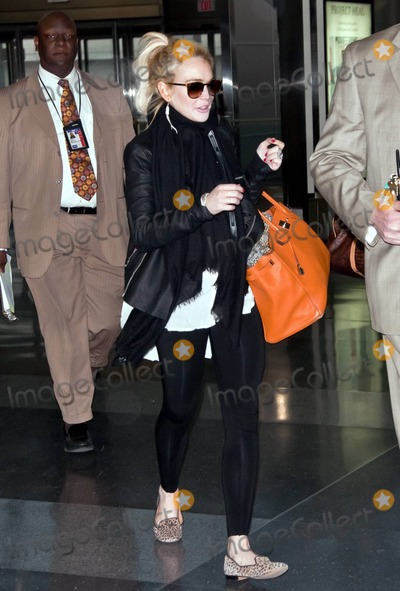 Sharon Tate Photo - Lindsay Lohan looks to be in good spirits as she heads for a flight at New Yorks JFK International Airport Lohan who carried an orange handbag and wore a black jacket and black scarf over a white top paired with black leggings and animal print shoes covered her face as she walked through the terminal accompanied by bodyguards Despite her recent legal problems Lindsay is reportedly up for two very different film roles She will reportedly be auditioning for the part of a villain in the new Superman movie And reports say she is up for the role of Sharon Tate in an upcoming film about Charles Manson New York NY 4611