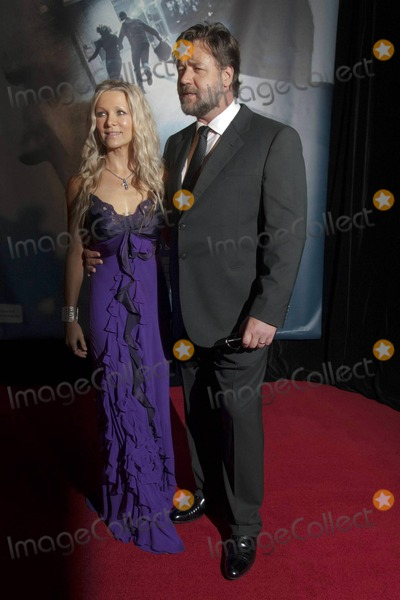Danielle Spencer Photo - A bearded Russell Crowe wraps his arm around his wife Danielle Spencers waist and poses on the red carpet at the Australia premiere of The Next Three Days held at Hoyts EQ  Crowe arrived in his sunglasses and looked attentively at his wife before removing his shades for photographers Sydney AUS 013011