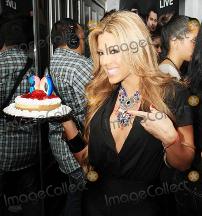Ana Carolina da Fonseca Photo - Rapper Pitbull (aka Armando Christian Perez) celebrates his 30th birthday at Play nightclub with friends that included Mexican pop singer Cristian Castro former Major League Baseball player Sammy Sosa Brazilian-born actress Ana Carolina da Fonseca who surprised Pitbull when she walked out of a giant faux cake and Latin pop singer and actor Jencarlos Canela  Pitbull appeared to be in a great mood as he kissed and hugged Ana Carolina stuck out his tongue and posed with a comical sculpture of himself Pictured Escandalo TV host Miami FL 011511
