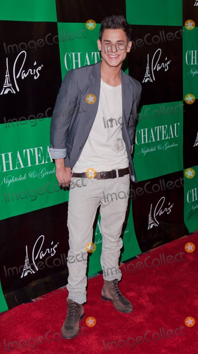 Kiowa Gordon Photo - Twilight star Kiowa Gordon poses for photographers at Chateau Nightclub inside the Paris Hotel to celebrate his and Twilight co-star Tinsel Koreys birthdays Las Vegas NV 032611