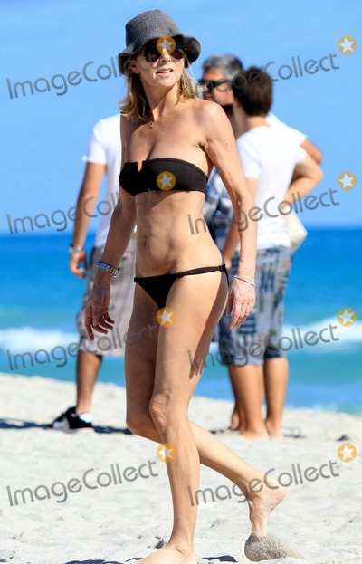 Arnaud Lemaire Photo - French journalist romance writer and director of news at TF1 Claire Chazal wears a black bikini as she relaxes on the beach during a winter holiday with husband Arnaud Lemaire Chazal who also presents Jenous de Claire on gay network Pink TV took a stroll on the beach and seemed to be enjoying the warm South Florida sun as she lounged beachside with Lemaire Miami Beach FL 122110