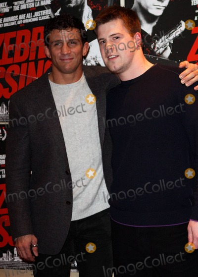 Alex Reid Photo - Mix-martial artist Alex Reid soon-to-be ex-husband of glamour model Kaite Price (aka Jordan) appears in good spirits as he gives the thumbs up and drinks a beer at the premiere of Zebra Crossing held at Empire Leicester Square  Alex who wore his wedding ring looked relaxed while hanging out among the other guests including actress Emma Rigby despite reports that Katie has decided to sell up house and move to the country because he refuses to leave the home they once shared London UK 012611