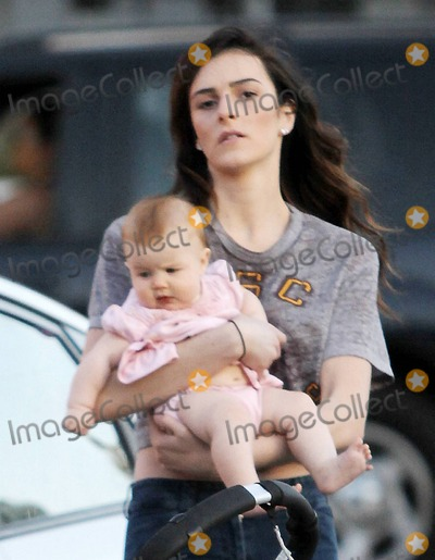 Ali Lohan Photo - EXCLUSIVE Ali Lohan helps a friend with her child while visiting sister Lindsay at her Los Angeles home Los Angeles CA 43011Fees must be agreed prior to publication