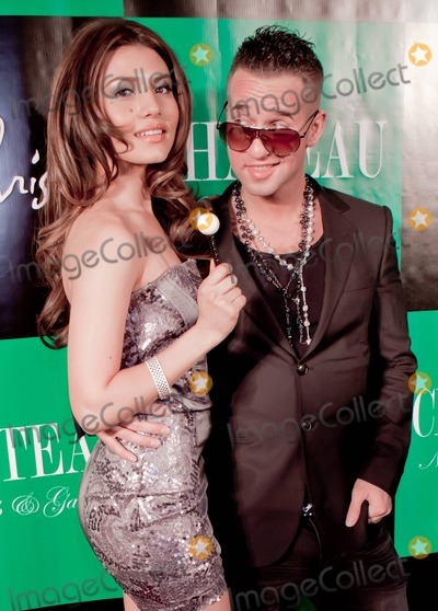 Mike The Situation Sorrentino Photo - In a jacket that appeared a bit too tight around his middle Mike The Situation Sorrentino of the MTV reality show Jersey Shore wears rosary-bead necklaces and aviators as he poses for photographers with Marcy Depena as he hosts an evening at Chateau Nightclub  Gardens at Paris Las Vegas Las Vegas NV 031111