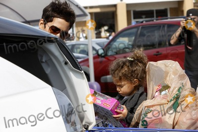 Lena Horne Photo - A day after paying tribute to the late Lena Horne at the Academy Awards actress Halle Berry takes daughter Nahla on a shopping trip to Toys R Us The two leave with a cart full of bags from their shopping trip which Halle loaded into her SUV which already looked to have quite a few items packed in the back Before loading though Halle made sure to give Nahla a toy to play with Beverly Hills CA 22811