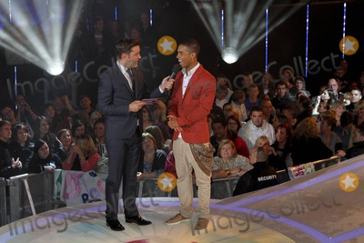 Lucien Laviscount Photo - Host Brian Dowling and Lucien Laviscount as he arrives as a guest in the Big Brother House held at Elstree Studios London UK 18th August 2011
