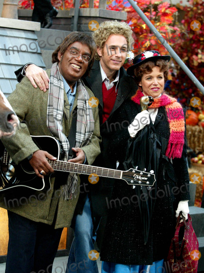 Al Roker Photo - AL Roker Matt Lauer and Katie Couric at Nbcs Today Show Annual Halloween Contest in Rockefeller Plaza at the NBC Studios on October 31 2003 Photo Henry McgeeGlobe Photos Inc 2003