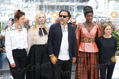 Alejandro Gonzalez Inarritu Photo - CANNES FRANCE - MAY 14 Jury Members Alice Rohrwacher Elle Fanning President of the Main competition jury Alejandro Gonzalez Inarritu Maimouna NDiaye and Kelly Reichardt attend the Jury photocall during the 72nd annual Cannes Film Festival on May 14 2019 in Cannes France (Photo by Laurent KoffelImageCollectcom)