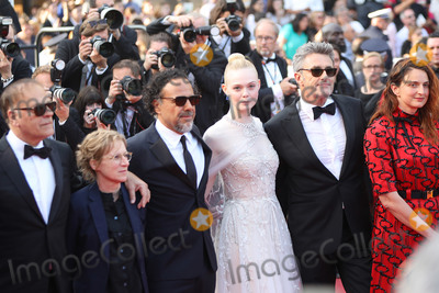 Bilal Photo - CANNES FRANCE - MAY 25 (L-R) Jury Members Alice Rohrwacher Pawel Pawlikowski Elle Fanning Alejandro Gonzalez Inarritu Kelly Reichardt and Enki Bilal attend the closing ceremony screening of The Specials during the 72nd annual Cannes Film Festival on May 25 2019 in Cannes France (Photo by Laurent KoffelImageCollectcom)