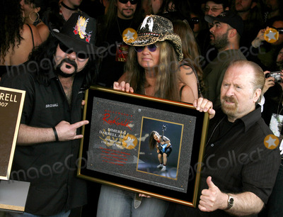 Dimebag Darrell Photo - Vinnie Paul Abbott and Rita Haney attend the Posthumoustly Induction of legenadary metal guitarist Dimebag Darrell Abbott into Hollywoods RockWalk held at the Guitar Center in Hollywood California on May 17 2007  Copyright 2007 by Arno GranPopular Images