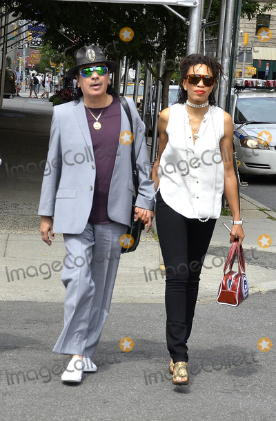 Cindy Blackman Photo - July 27 2012 New York CityCarlos Santana and Cindy Blackman strolling in SoHo on July 27 2012 in New York City