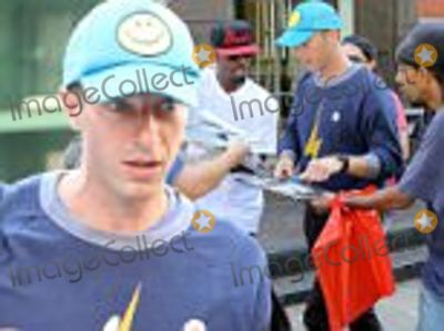 Chris Martin Photo - July 17 2016  Singer Chris Martin was swarmed by fans in New York City New York The Coldplay frontman sported a blue cap with a smiley face and a lightning bolt printed sweater  Non Exclusive UK RIGHTS ONLY  Pictures by  FameFlynet UK  2016 Tel  44 (0)20 3551 5049 Email  infocopyrightfameflynetukcom