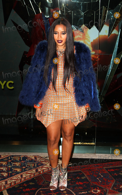 Angela Simmons Photo - December 12 2013 New York CityAngela Simmons at the Just Cavalli Soho Flagship store opening at Just Cavalli Soho on December 12 2013 in New York City