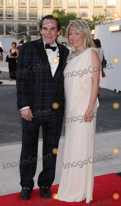 Couri Hay Photo - Publicist R Couri Hay and Janna Bullock arriving at the 2009 New York City Ballet Spring Gala at the David H Koch Theater at the Lincoln Center on May 13 2009 in New York City