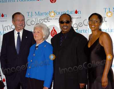 Aisha Morris Photo - Ex-President George Bush his wife Barbara singer Stevie Wonder and his daughter Aisha Morris at the TJ Martell Foundation Awards Gala at the Hilton Hotel in New York City George and Barabara Bush and Stevie Wonder all received awards from the Foundation May 27 2004