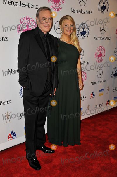 Neil Diamond Photo - October 20 2012 Los Angeles CANeil Diamond and Katie McNeil  arriving at the 26th Anniversary Carousel Of Hope Ball at The Beverly Hilton Hotel on October 20 2012 in Beverly Hills California