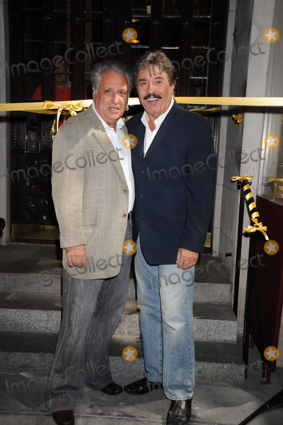Tony Orlando Photo - Stewie Stone and Tony Orlando pose as Orlando is honored with the worlds largest yellow ribbon outside the Friars Club on September 2 2008 in New York City