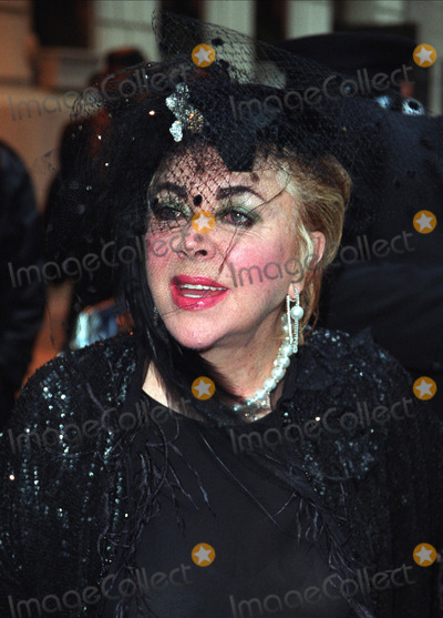 Liza Minnelli Photo - ELIZABETH TAYLOR leaves her uptown hotel to go to Liza Minnellis wedding New York March 16 2002  2002 by Alecsey BoldeskulNY Photo Press     PAY-PER-USE          NY Photo Press    phone (646) 267-6913     e-mail infocopyrightnyphotopresscom
