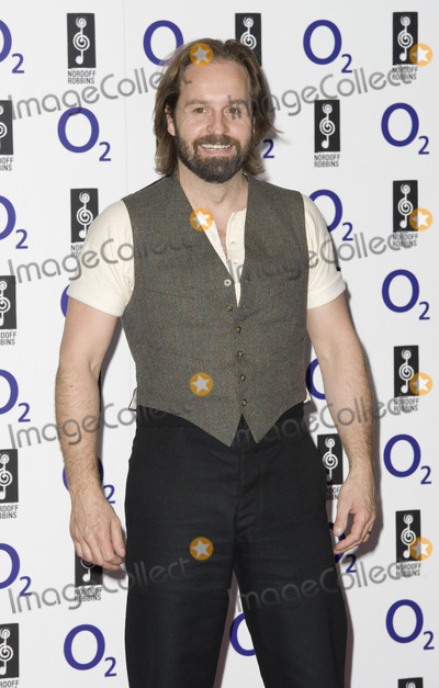 Alfie Boe Photo - Alfie Boe arrives for the Silver Clef Awards 2011 at the Park ane Hilton London 01072011 Picture by Simon Burchell  Featureflash