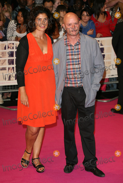 Amanda Posey Photo - Nick Hornby and Amanda Posey arriving for the European Premiere of One Day at Westfield west London 23082011  Picture by Alexandra Glen  Featureflash