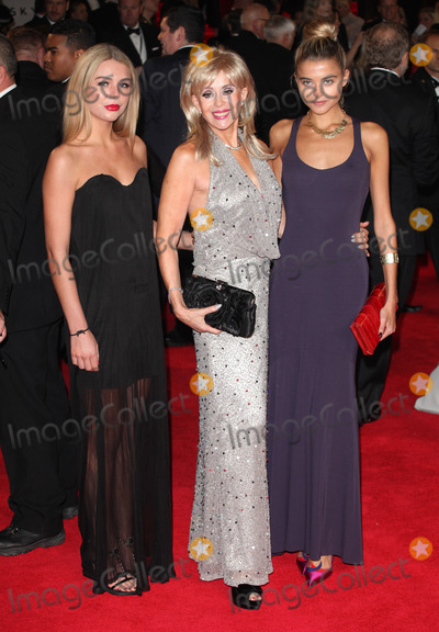 Sally Farmiloe Photo - Sally Farmiloe and daughters arriving for the Royal World Premiere of Skyfall at Royal Albert Hall London 23102012 Picture by Alexandra Glen  Featureflash