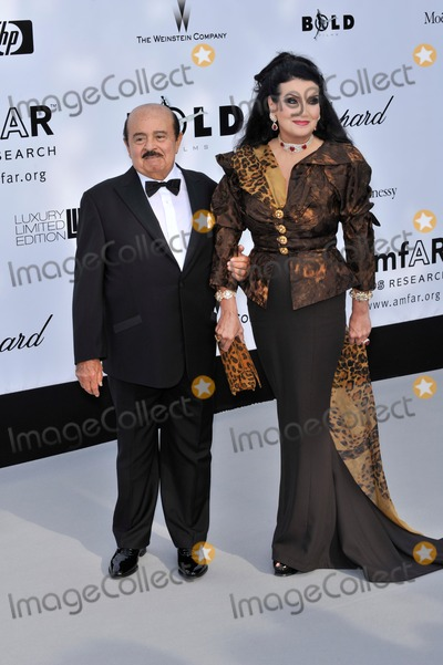 Adnan Khashoggi Photo - Adnan Khashoggi  Lamia Khashoggi at amfARs Cinema Against AIDS 2008 Gala at Le Moulin de Mougins restaurant The event is part of  the 61st Annual International Film Festival de Cannes May 22 2008  Cannes FrancePicture Paul Smith  Featureflash