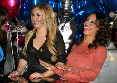 Amelle Berrabah Photo - Sugababes Heidi Range and Amelle Berrabah celebrating the launch of BBC Children in Need POP Goes the Musical at Kensington Roof Gardens west London 31082011 Picture by Alexandra Glen  Featureflash