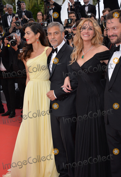 Amal Clooney Photo - Actor George Clooney  wife Amal Clooney with actors Julia Roberts  Dominic West at the gala premiere for Money Monster at the 69th Festival de CannesMay 12 2016  Cannes FrancePicture Paul Smith  Featureflash