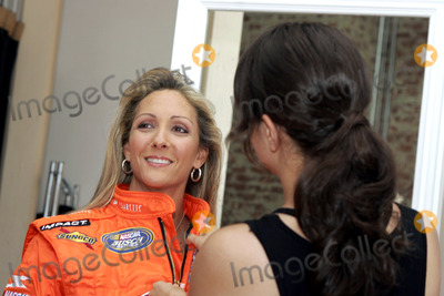 Kim Crosby Photo - Female Nascar driver Kim Crosby during a photo shoot with her new sponsor Vassarette Lingeries new driving suit gets some help from a stylist August 23 2005 in New York City