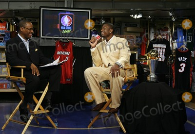 Andre Aldridge Photo - The 2006 NBA Finals MVP Dwayne Wade during an interview with NBAcoms Andre Aldridge at the NBA Store on June 22 2006 in New York City