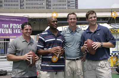 Amani Toomer Photo - From left  NY Giants place kicker Jay Feely NY Giants wide receiver Amani Toomer Indianapolis Colts quarterback Peyton Manning and his brother NY Giants quarterback Eli Manning during the kick off of Fantasy Football training camp at the South Street Seaport July 18 2005 in New York City