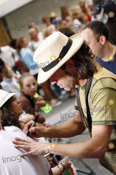 Big Kenny Alphin Photo - Big Kenny Alphin of the country duo Big And Rich signs autographs during The Today Show on July 8 2006 in