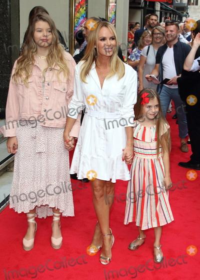 Amanda Holden Photo - London UK Amanda Holden and daughters at Joseph and the Amazing Technicolor Dreamcoat Press Night at the London Palladium London on July 11th 2019Ref LMK73-J5163-120719Keith MayhewLandmark MediaWWWLMKMEDIACOM