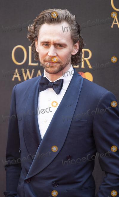 Tom Hiddlestone Photo - London UK Tom Hiddleston at The Olivier Awards 2019 with Mastercard at Royal Albert Hall on April 7 2019 in London England 7th April 2019Ref LMK386-J4701-080419Gary MitchellLandmark MediaWWWLMKMEDIACOM