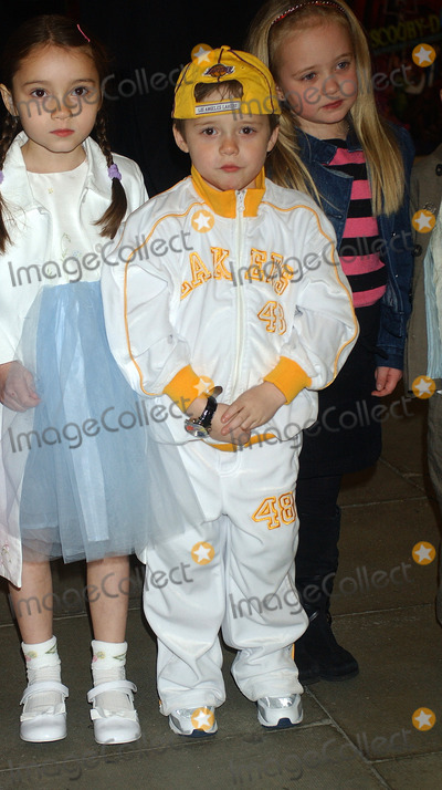 Scooby-Doo Photo - London Brooklyn Beckham (with hat) who is the son of Victoria Posh Spice  Beckham  and husband international football player David Beckham   at the London premiere of  Scooby-Doo 2 Monsters Unleashed    26th March 2004 PICTURES BY RAOUL TREZARILANDMARK MEDIA LMK