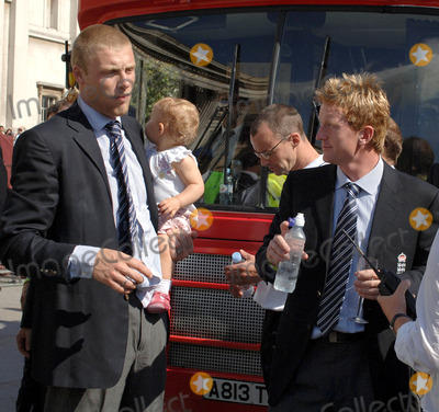 Andrew Flintoff Photo - LondonPaul Collingwood Andrew Flintoff and his Daughter celebrate winning the Ashes back afer 18 years on the double decker bus that took the England team on a parade through London ending in Trafalgar Square Thousands of fans made an appearance to cheer on their new heros The event has been compared to England winning the Rugby World Cup in 2003 and also the Football World Cup in 1966September 13th 2005Picture by Ali KadinskyLandmark Media
