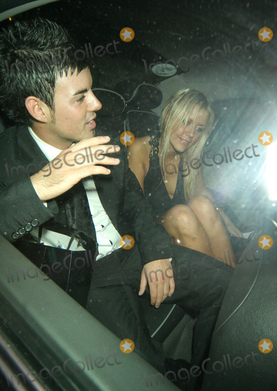 Anthony Hutton Photo - London Big Brother 6 winner Anthony Hutton and lady friend leave the TV Quick  TV Choice Awards 2005 held at Dorchester Hotel05 September 2005FlashburstLandmark Media