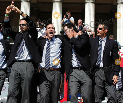Ashley Giles Photo - LondonMichael Vaughan Simon Jones Kevin Pietersen and Ashley Giles celebrate winning the Ashes back afer 18 years at the victory parade that ended in Trafalgar Square Thousands of fans made an appearance to cheer on their new heros The event has been compared to England winning the Rugby World Cup in 2003 and also the Football World Cup in 1966September 13th 2005Picture by Ali KadinskyLandmark Media