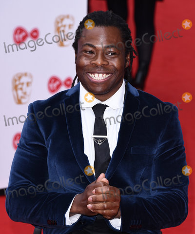 Ade Adepitan Photo - London UK  Ade Adepitan at The Virgin TV British Academy (BAFTA) Television Awards 2017 held at The Royal Festival Hall Belvedere Road London on Sunday 14 May 2017Ref LMK392-J277-150517Vivienne VincentLandmark Media WWWLMKMEDIACOM
