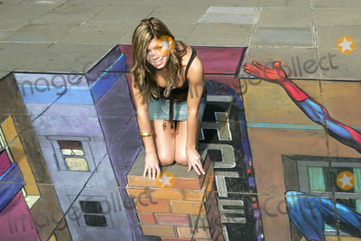Julian Beever Photo - London Coronation Street star Nikki Sanderson with 3D pavement chalk drawing of Spiderman by artist Julian Beever for the release of the new Spiderman X-Box game16 October 2005Paulo PirezLandmark Media