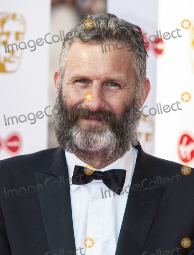 Adam Hills Photo - London UK Adam Hills  at the Virgin Media British Academy Television Awards at The Royal Festival Hall 12th May 2019 Ref LMK386 -S2416-150519Gary MitchellLandmark Media   WWWLMKMEDIACOM